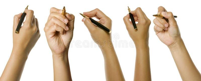Insieme della penna di holding delle mani fotografie stock libere da diritti
