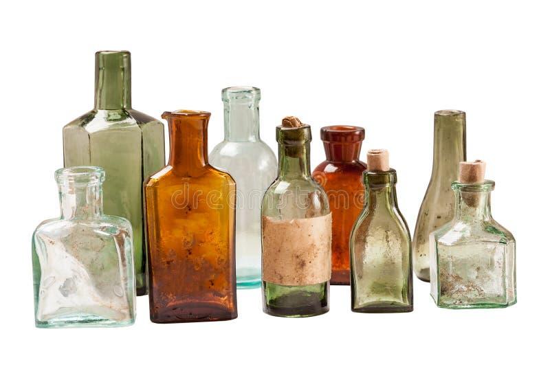 Insieme delle bottiglie di vetro d'annata isolate su bianco fotografia stock