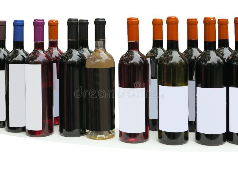 Insieme delle bottiglie di vino adenoide isolate sopra bianco immagini stock