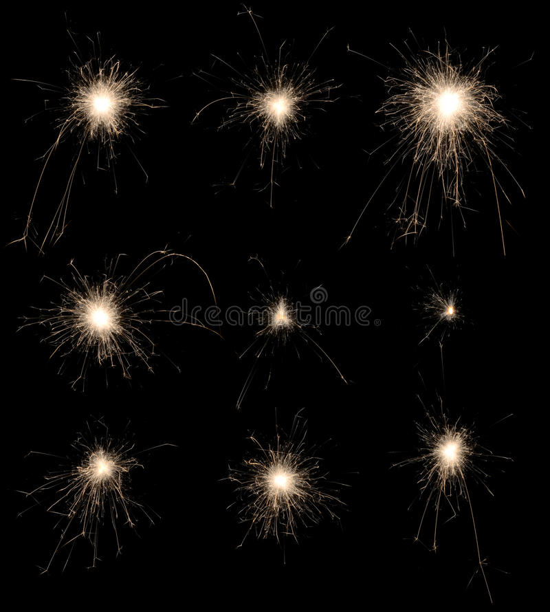 Insieme delle stelle filante brucianti su fondo nero. fotografia stock libera da diritti