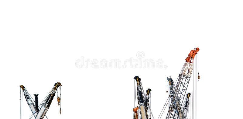 Insieme di grande gru di costruzione per il sollevamento pesante isolato su fondo bianco Industria dell'edilizia gru per l'ascens immagini stock