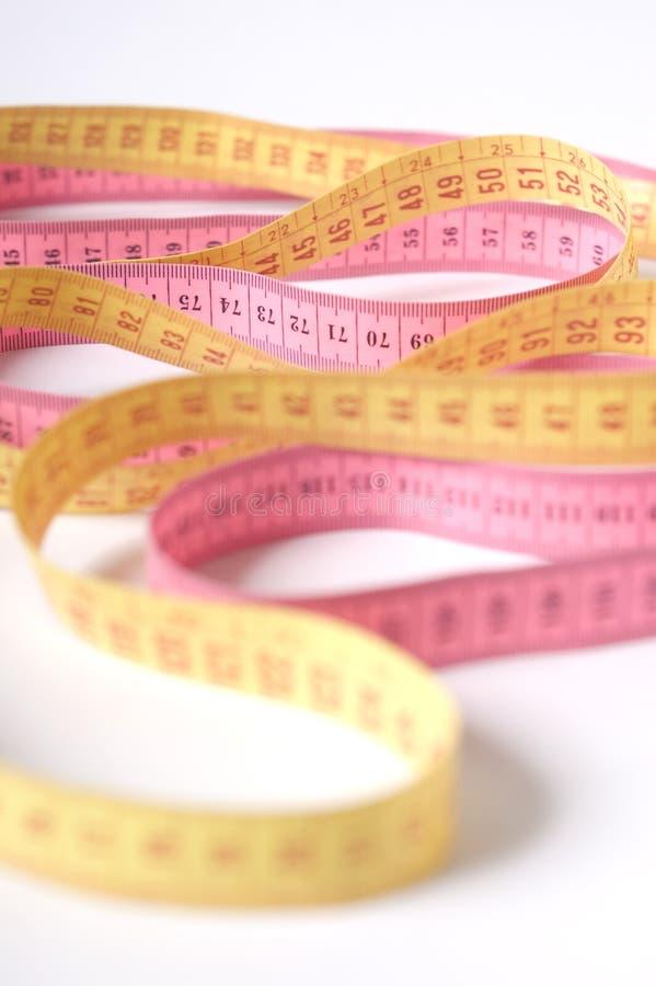 Insieme di nastro di misurazione Colourful in onde fotografia stock