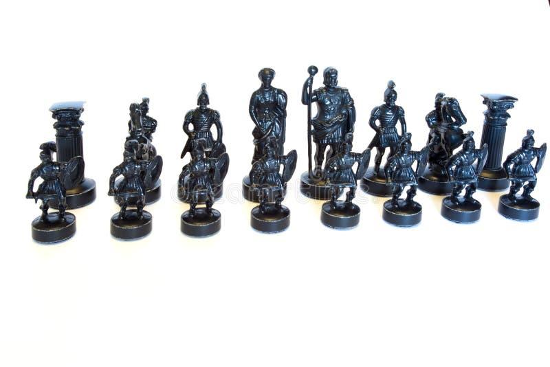 Insieme di scacchi della pietra sui precedenti bianchi fotografia stock libera da diritti