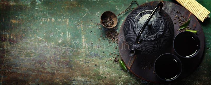 Insieme di tè asiatico del ferro nero fotografia stock