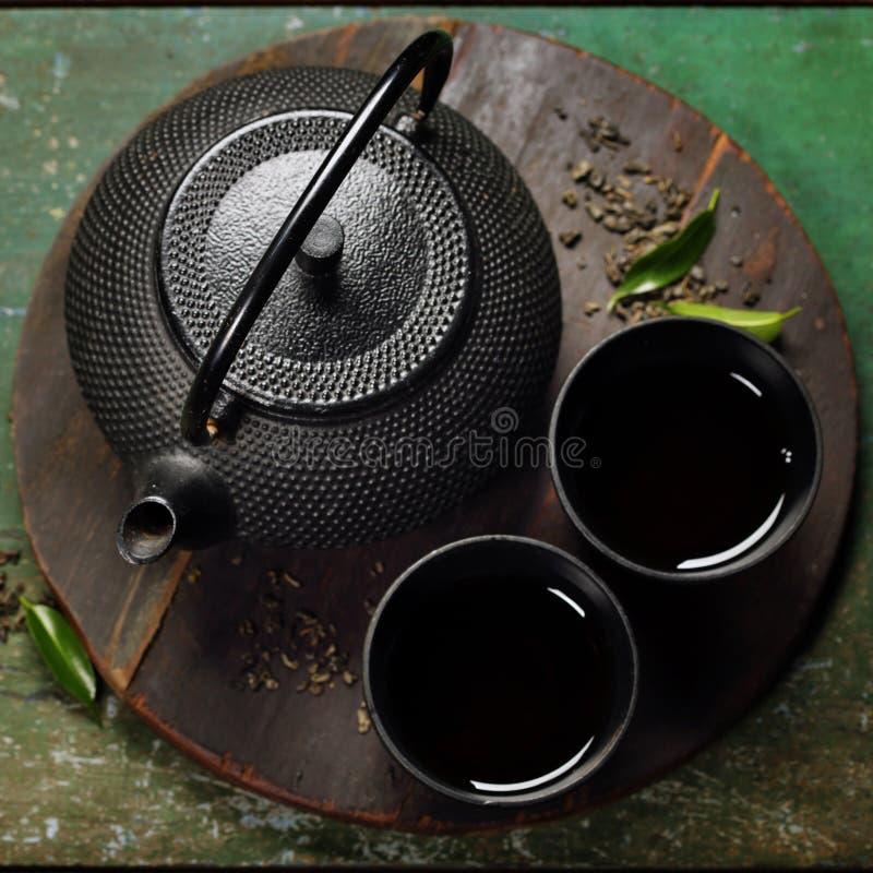 Insieme di tè asiatico del ferro nero immagini stock libere da diritti