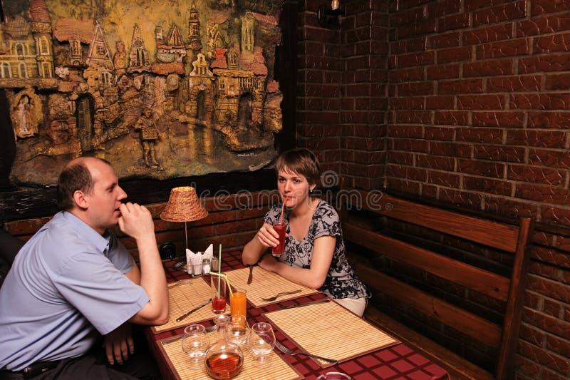 Insieme in ristorante fotografia stock