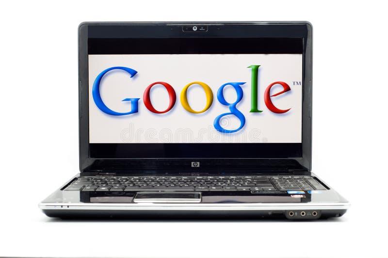 Insignia de Google en la computadora portátil del HP fotografía de archivo
