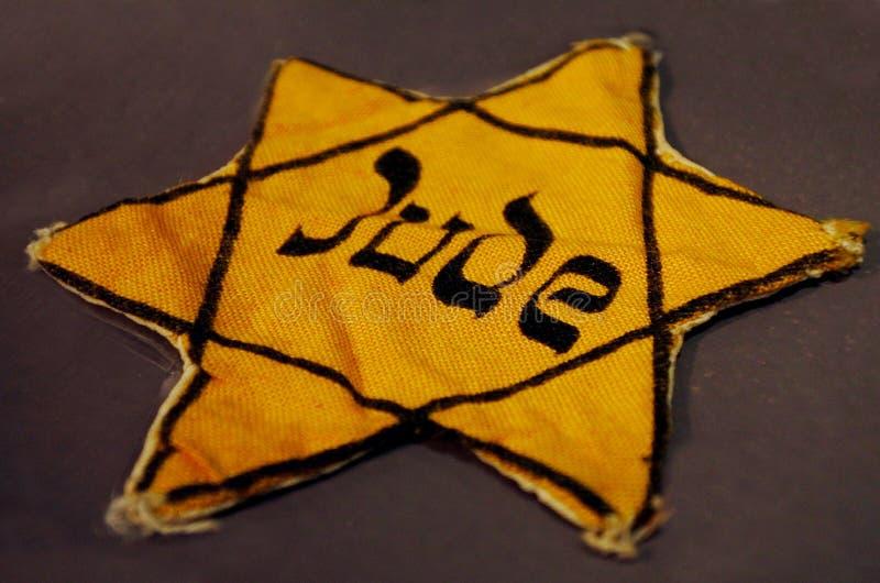 Insignia judía amarilla imagen de archivo
