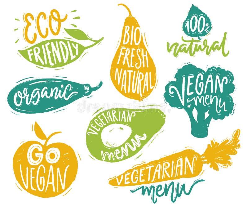 Insignias y etiquetas engomadas vegetarianas del menú para el café y los restaurantes Texto del vegano en las etiquetas de la ver ilustración del vector