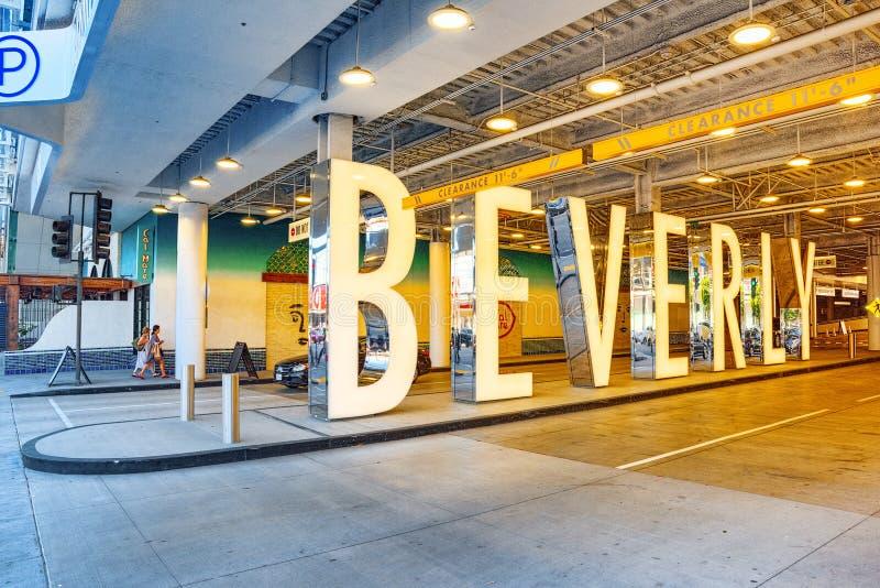 Inskrift - BEVERLI och stads- sikter av det Beverly Hills området royaltyfria foton