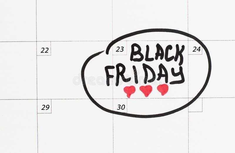 Inskrift Black Friday på kalendern 2018, vit bakgrund arkivfoto