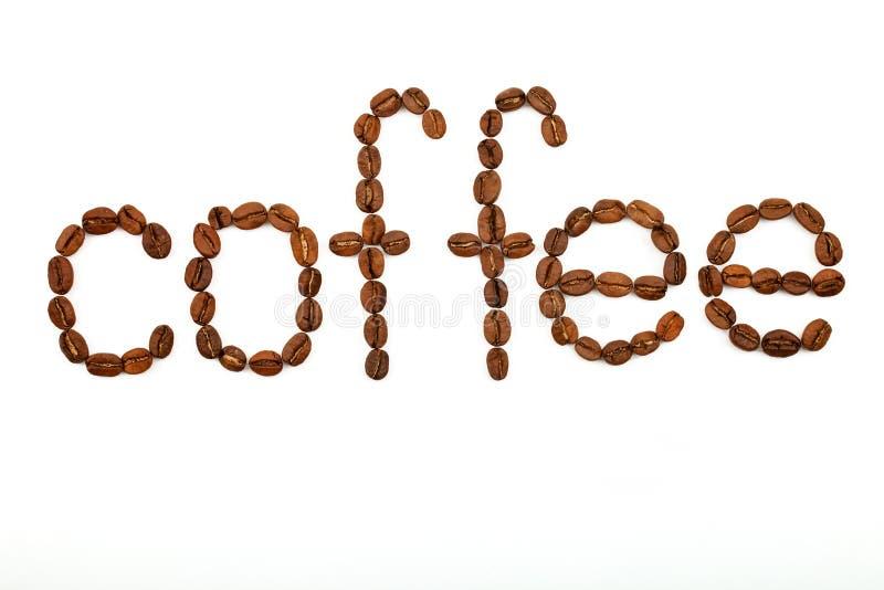 Inskrypcja od kawowych fasoli słów kawa na białym tle zdjęcia stock