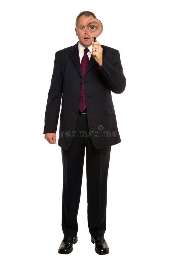 Inspeção próxima do homem de negócios. fotografia de stock