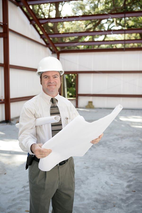Inspecteur de construction avec des modèles image stock