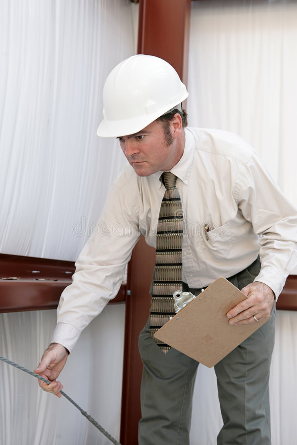Inspecteur de construction - tension de test photo stock