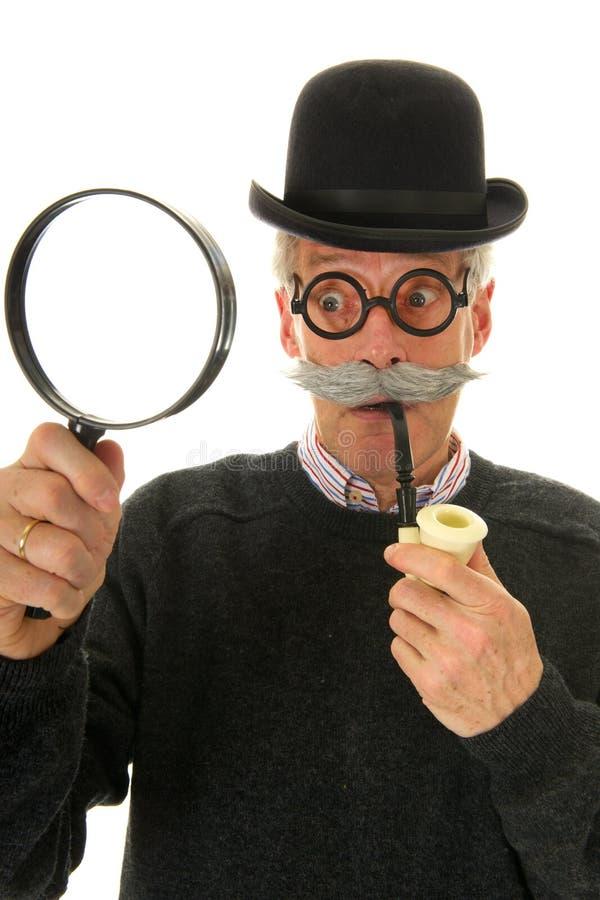 Inspecteur met meer magnifier royalty-vrije stock fotografie
