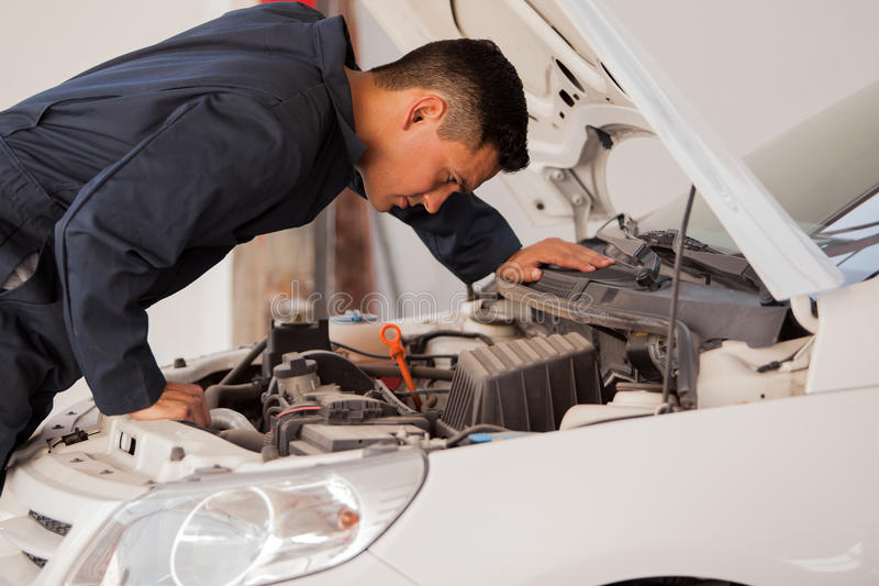 Inspecting a car engine royalty free stock images