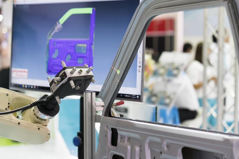 Inspection automotive part dimension. By 3D scan measuring machine. Quality check and control by automatic programing robot arm with 3D laser visual camera royalty free stock photo
