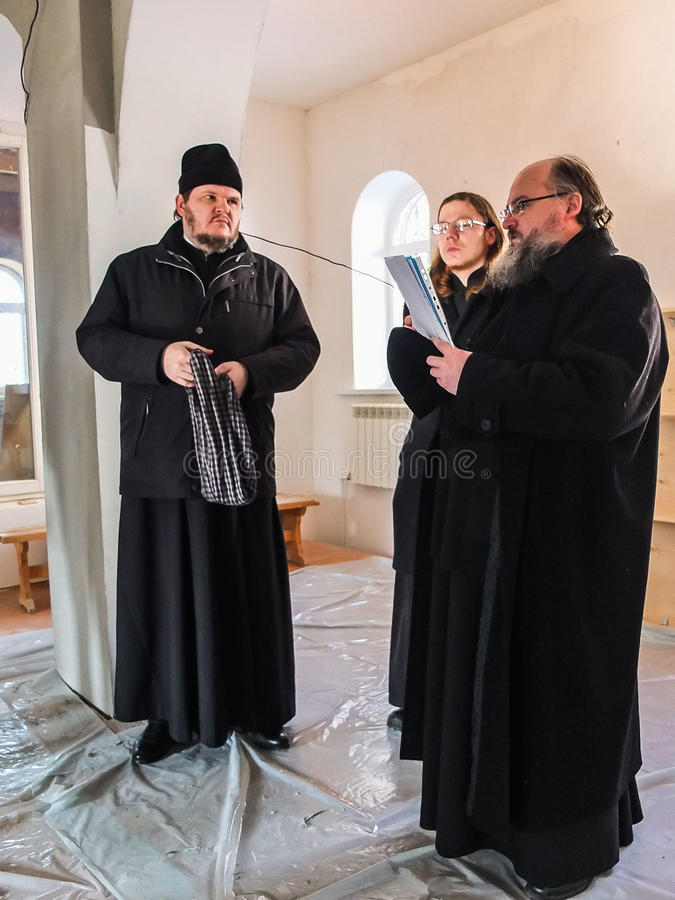 Inspection of the construction of the Church and the Episcopal service in the Kaluga region of Russia. stock photos