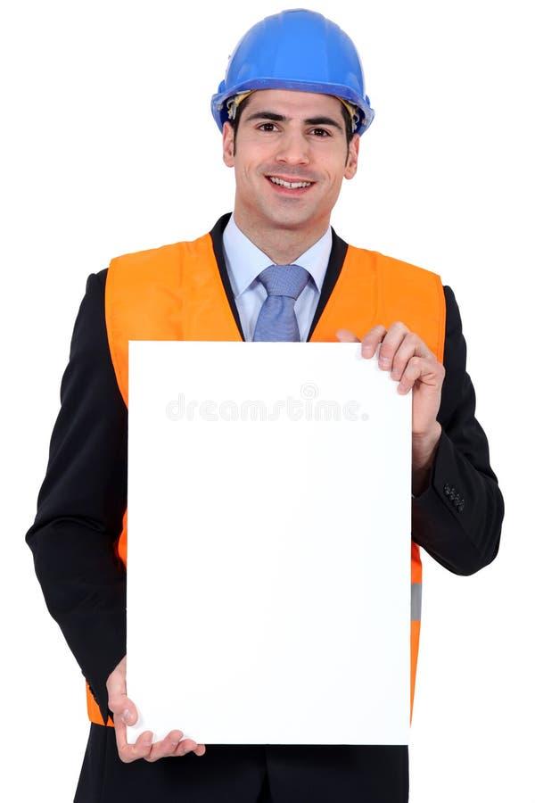 Inspector com um cartaz fotos de stock royalty free