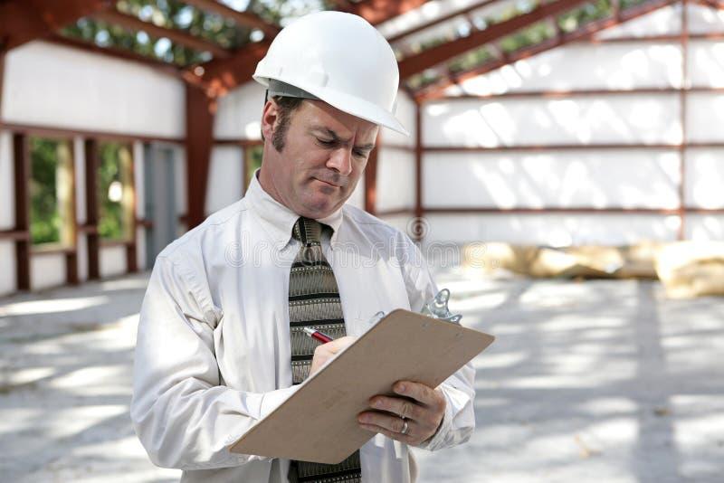 Inspector de la construcción - lista de comprobación de la marca imagen de archivo libre de regalías