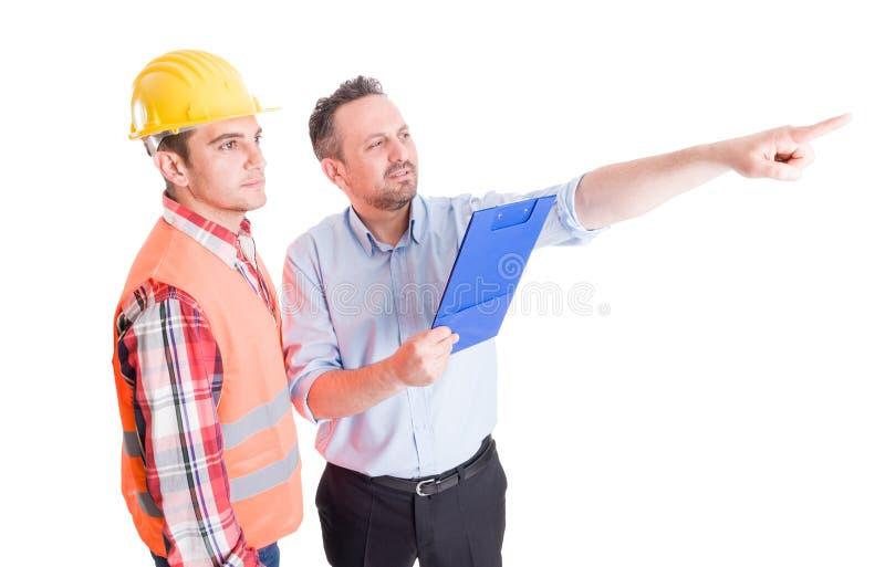 Inspector del sitio de Constrution y constructor o contratista imagen de archivo