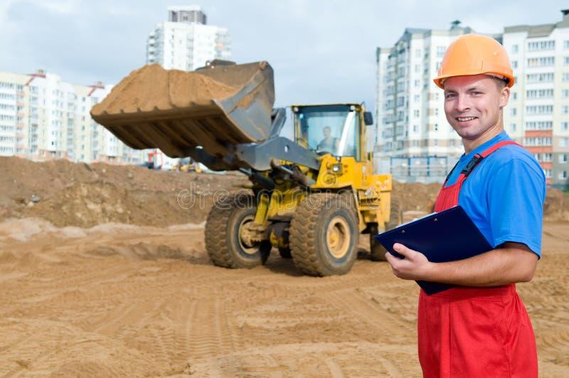 Inspector do construtor na construção foto de stock royalty free