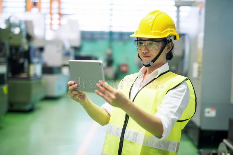 Inspector using tablet in manufactoring  factory stock photos