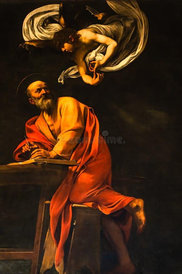 A inspiração de St Matthew por Caravaggio em 1602 fotos de stock