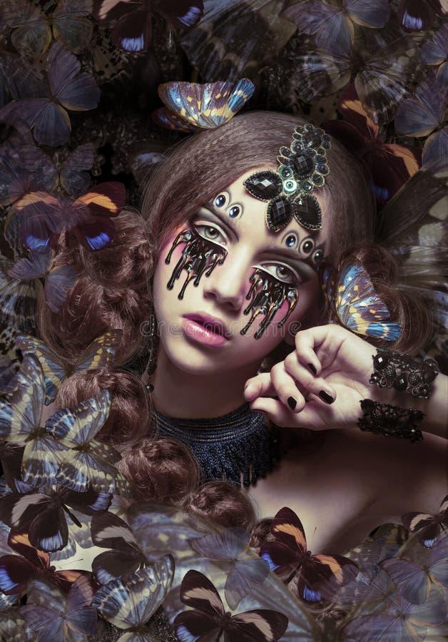 inspiratie Vrouw met Fantastische Tranen en Vlinders stock afbeelding