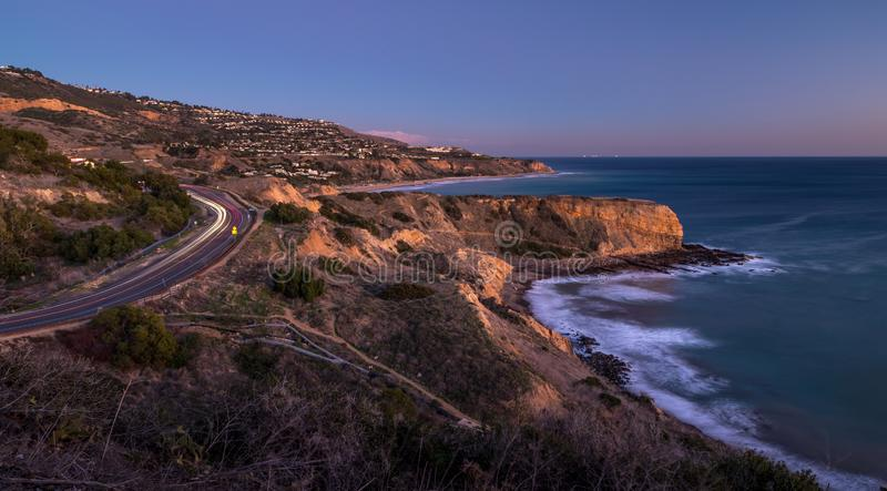 Inspiration Point and Palos Verdes Drive after Sunset. Long exposure photo of Inspiration Point cliff after sunset and light streaks from cars driving along royalty free stock photography