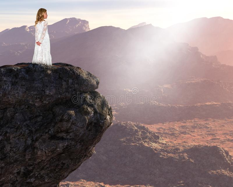 Inspiration, Spiritual Rebirth, Peace, Hope Love. A young girl stands above a surreal mountain landscape. Abstract concept for peace, hope, love, nature, and stock image