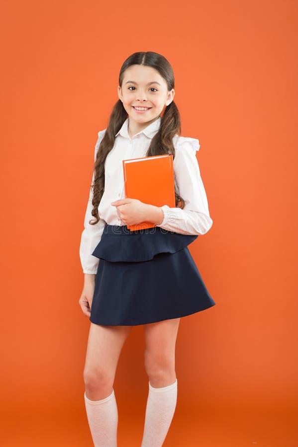 Inspiration for study. Back to school. Knowledge day. Possible everything. Schoolgirl enjoy study. Kid school uniform. Hold workbook. Child doing homework stock image