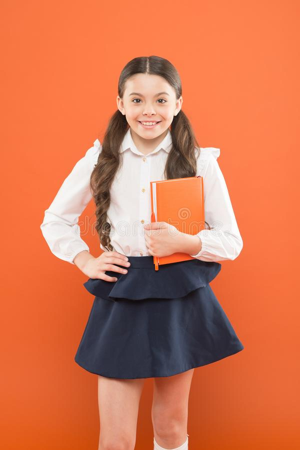 Inspiration for study. Back to school. Knowledge day. Possible everything. Schoolgirl enjoy study. Kid school uniform. Hold workbook. School lesson. Child doing royalty free stock images