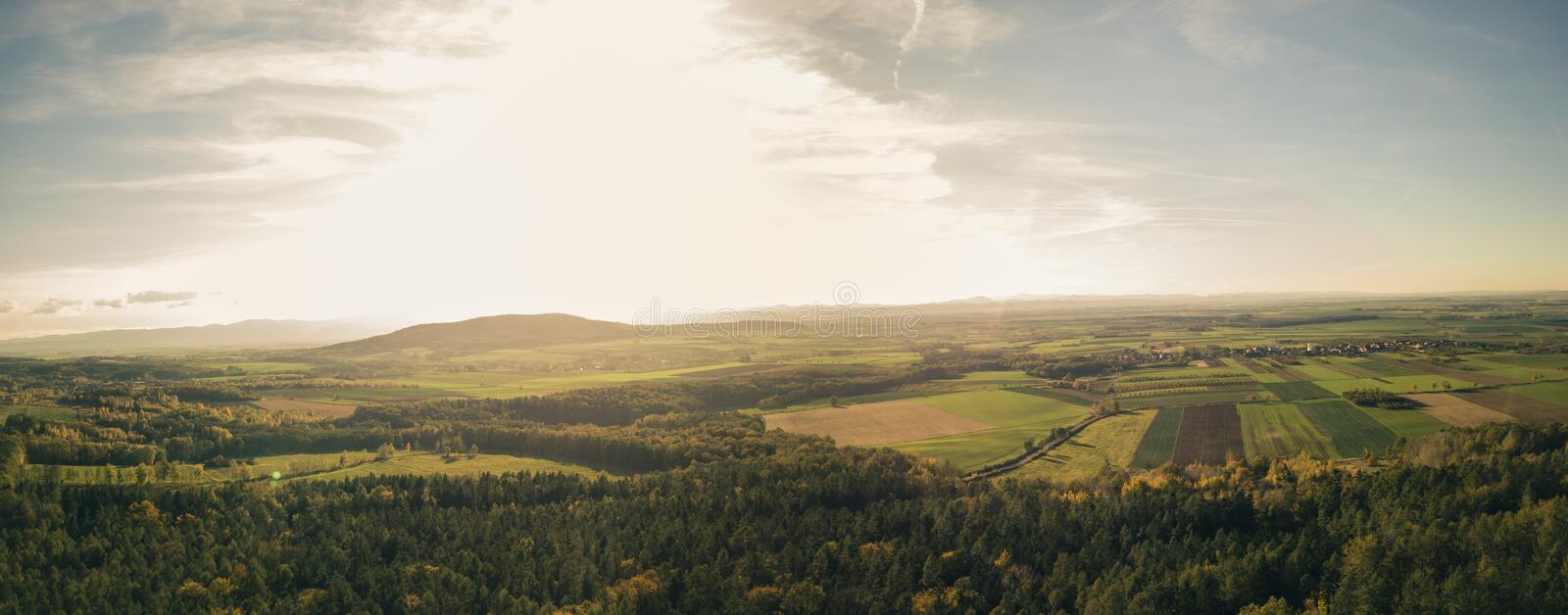 Inspirational aerial landscape, autumn forest and fields. Drone point of view. Inspiring autumn season landscape panorama royalty free stock photography
