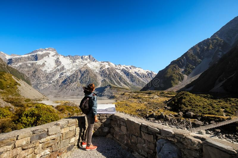 Inspirational concept of a traveler in New Zealand breathtaking view. Young man visiting Mount Cook New Zealand. Backpacking person enjoys beautiful natural stock photography