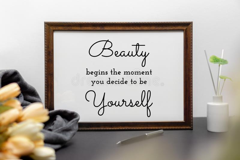 Inspirational and motivation beauty and life quote on wood frame. Inspirational and motivation beauty and life quote on wood frame - Beauty Begins the Moment royalty free stock image