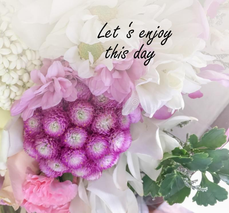 Inspirational and motivation on blurred flower background royalty free stock photography