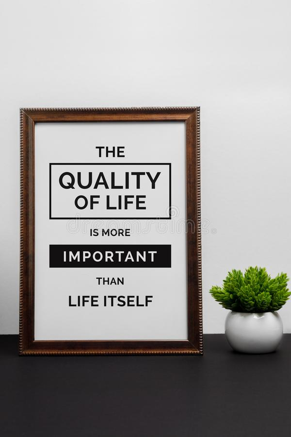 Inspirational and motivation life quote on wood frame. Inspirational and motivation life quote on wood frame - The Quality of Life is More Important Than Life stock images