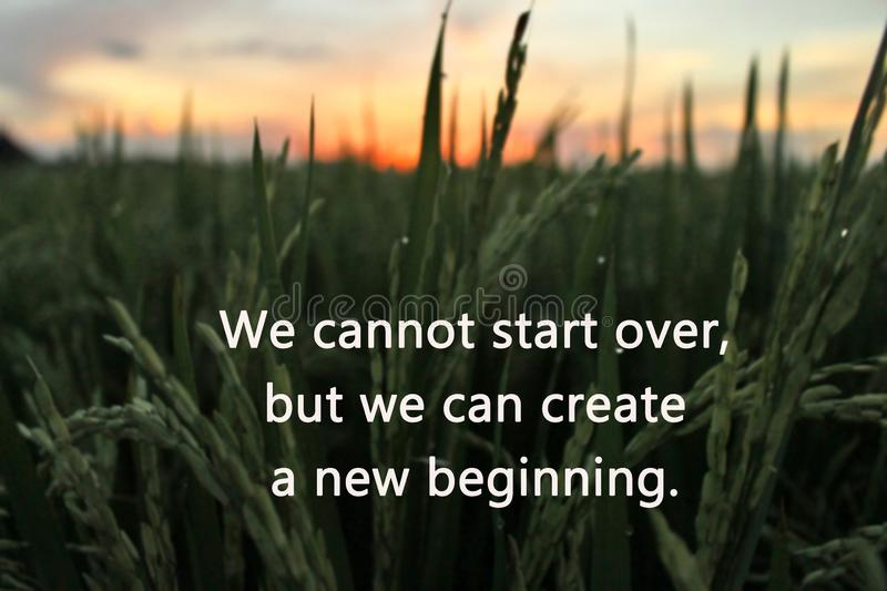 Inspirational motivational quote-we cannot start over, but we can create a new beginning. With blurry colorful sunrise light in royalty free stock photography