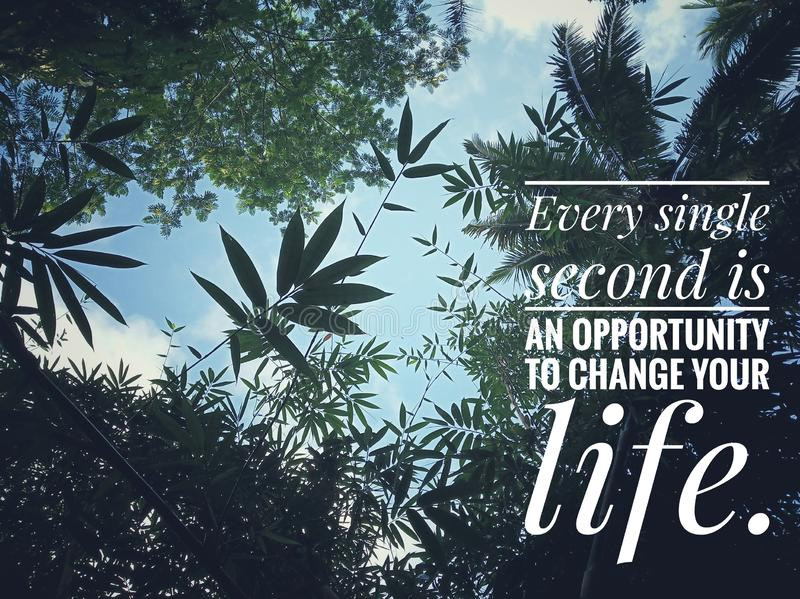 Inspirational motivational quote- Every single second is an opportunity to change your life. With beautiful nature of various. Green leaves above and blue sky stock photography