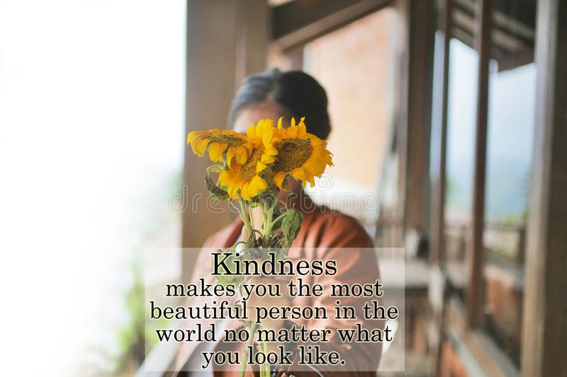 Inspirational motivational quote - Kindness make you the most beautiful person in the world no matter what you look like. stock photos