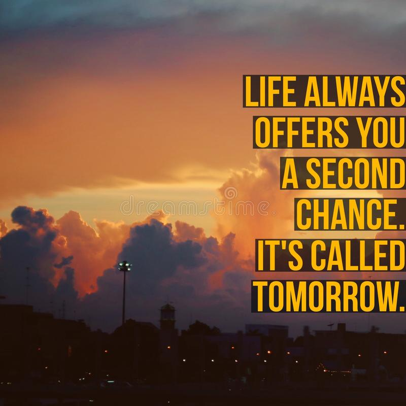 Inspirational motivational quote `life always offers you a second chance. It is called tomorrow.`. On sky and city background royalty free stock image