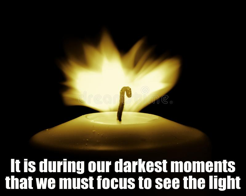 Inspirational Motivational Quote, Life Wisdom - It is during our darkest moments that we must focus to see the light stock image