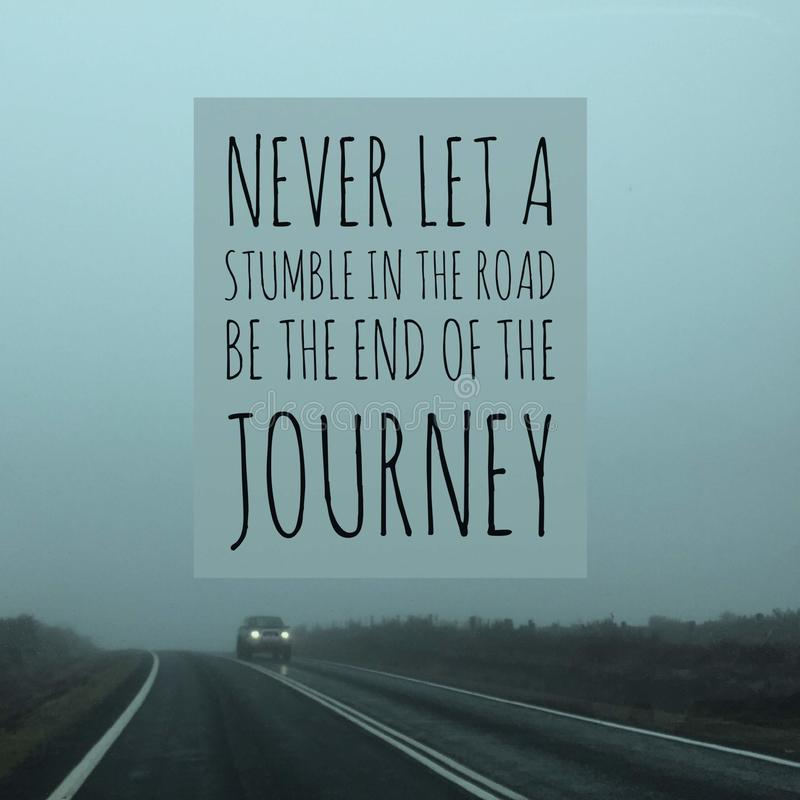 Inspirational motivational quote `never let a stumble in the road be the end of the journey` royalty free stock image