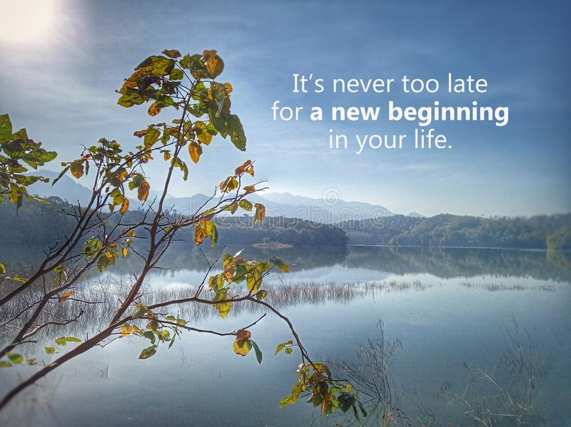 Inspirational motivational quote - It is never too late for a new beginning in your life. With sun morning light over beautiful. Nature blue lake scenery royalty free stock photos
