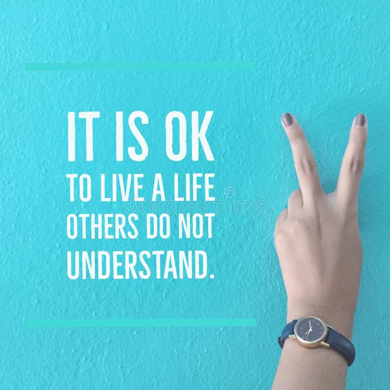Inspirational motivational quote `It is OK to live a life others do not understand` stock image