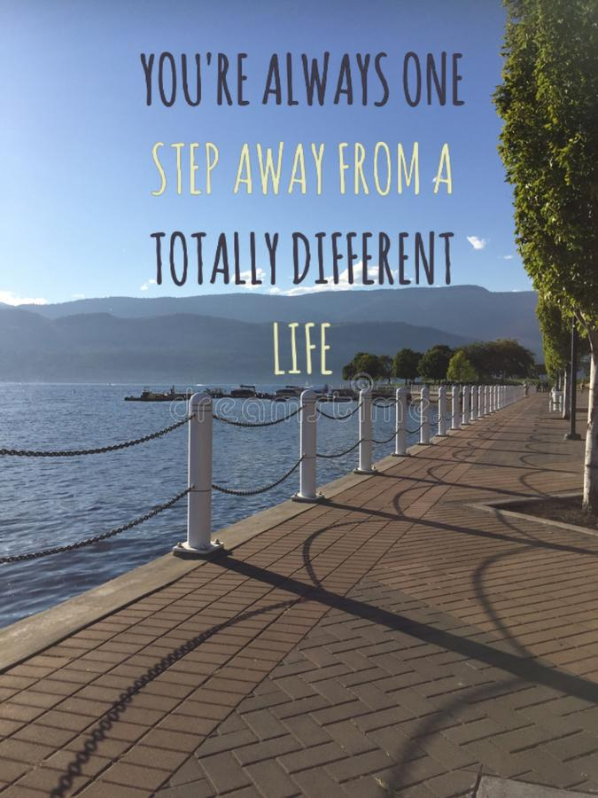 Inspirational motivational text on scenic lake view with brick walkway along lake shore. Conceptual image with words: You`re always one step away from a stock photo