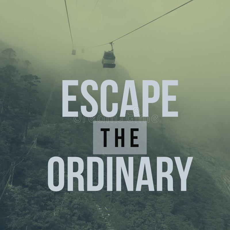 Inspirational motivational travel quote `escape the ordinary`. On cable car with mountain background stock photo
