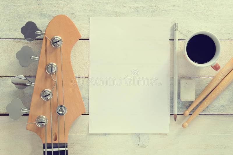Inspirational musician desktop composing. Electric Bass Guitar. Against a white wooden background. Editor's view. Wide copy space for editor's text stock photos